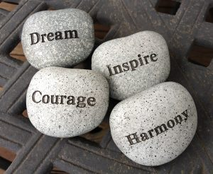 Stones with the words; dream, inspire, harmony & courage
