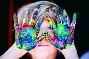 Small child with paint on his hands