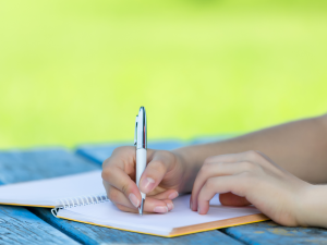 a close up of a person writing