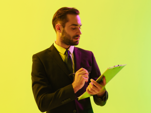 a man wearing a suit holding a clipboard